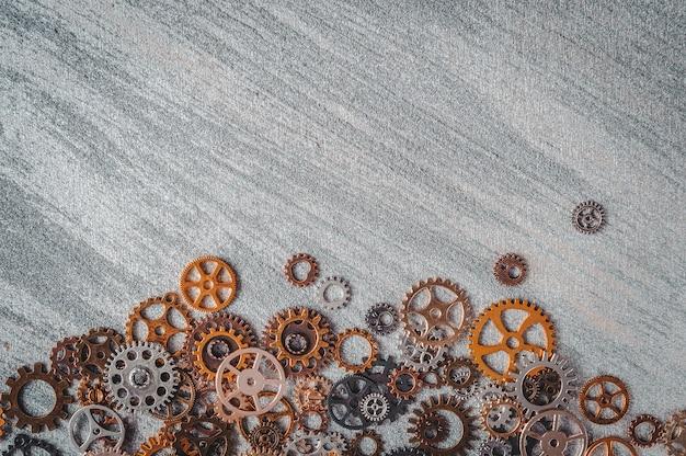 歯車と歯車を備えた銀色の表面。