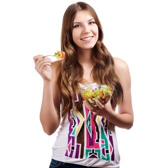 前向きでサラダとボールを保持している少女の肖像画