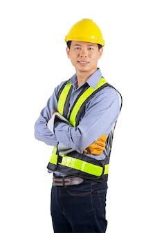黄色のヘルメットを保持しているエンジニア