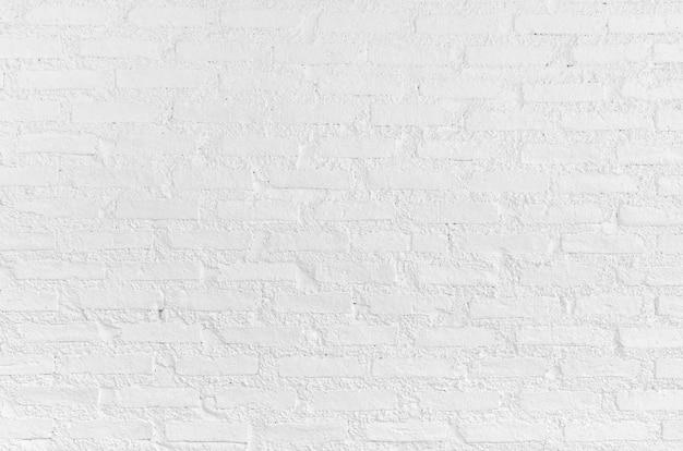 Белая гранжевая кирпичная стена