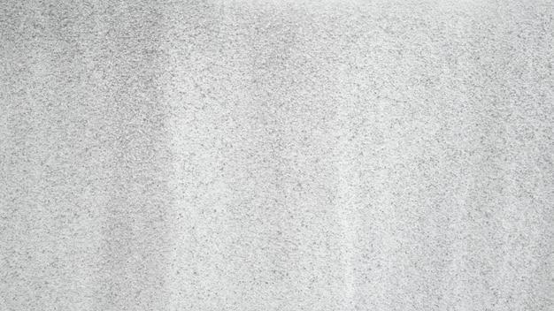 大まかなセメントの壁の背景テクスチャ、古い白いコンクリートの壁紙。