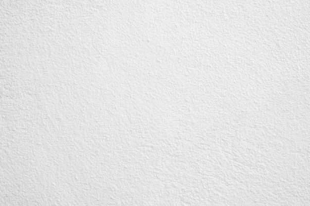 Предпосылка стены белого цемента, грубая текстура стены.