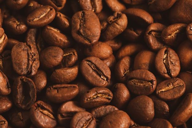 焙煎コーヒー豆のクローズアップ、トップビューのテクスチャ。