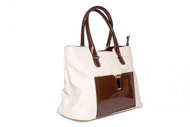 白い背景の上の女性のハンドバッグ
