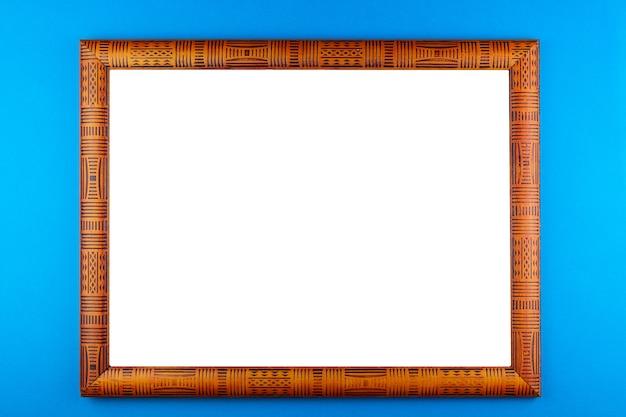 木製フレームブルーの背景