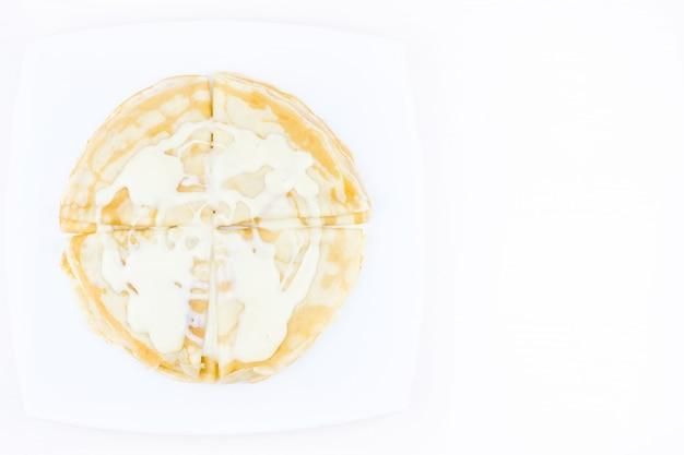コンデンスミルクでびっしょりのパンケーキ