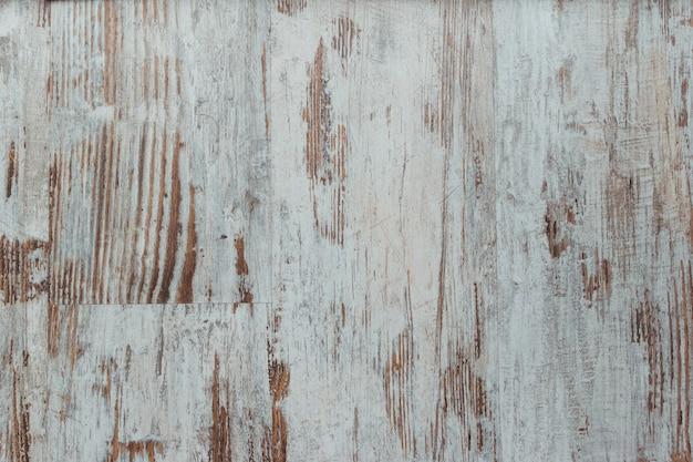 ぼろぼろのホワイトウッドの背景。グランジ風化表面