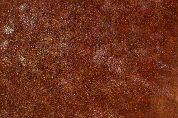 赤褐色の酸化された背景。グランジと不規則な表面。