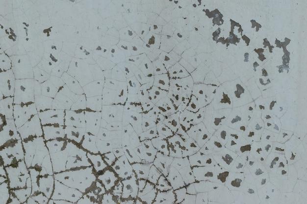 甘やかされて育ったチッピングペイント壁の背景。グランジの概念