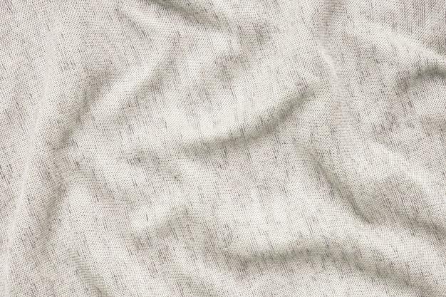 ベージュの布の白い背景のテクスチャ