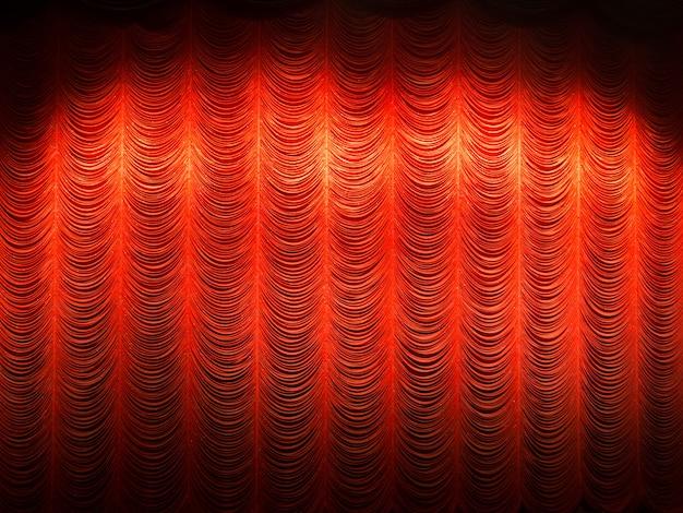 劇場で赤いレイヤーカーテンやドレープの背景にスポットライト