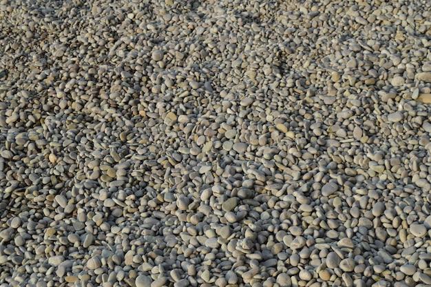 小石 - 丸い海の石と抽象的な背景