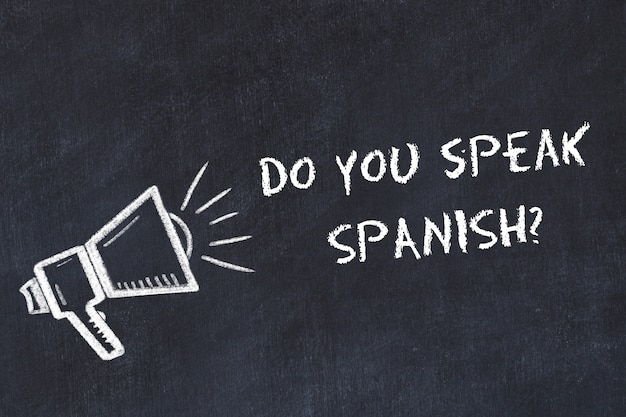 外国語の概念を学ぶフレーズとスピーカーのチョーク記号はスペイン語を話しますか
