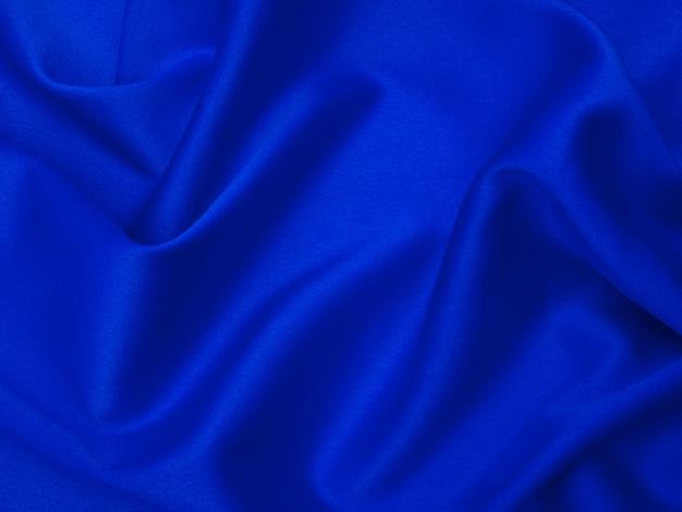 背景やテクスチャの青い絹織物。