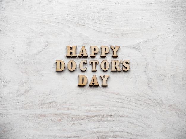 幸せな医者の日。美しいグリーティングカード。孤立した背景
