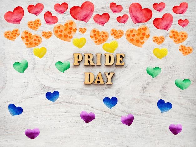 Текст дня гордости с сердцами радуги