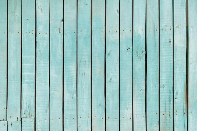 青い古い木の塀。木製の柵のテクスチャです。板の背景