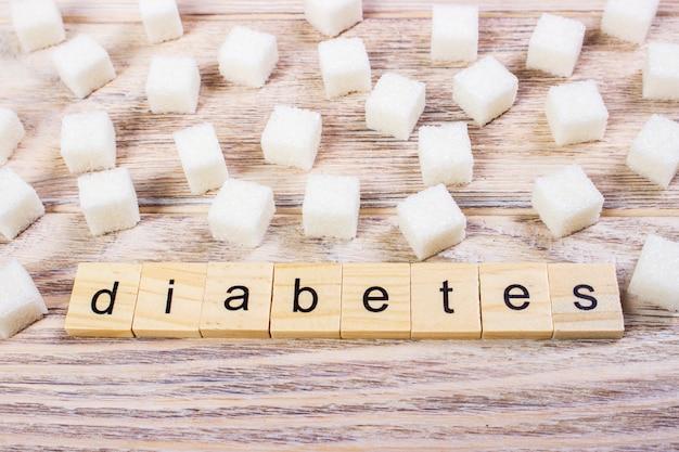 洗練された砂糖と木製のブロックの単語の「糖尿病」の単語