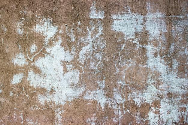 ひびの入ったコンクリートのヴィンテージの壁の背景、