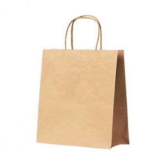 白い背景に分離された空白の茶色のリサイクル紙袋