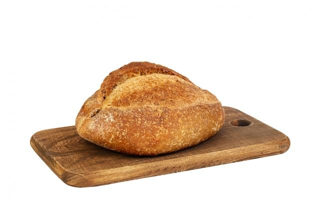 分離された木製のまな板にパン