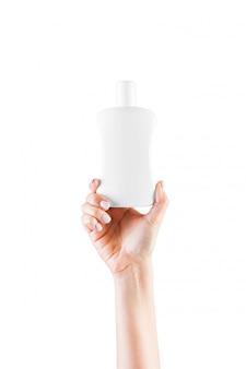 クリームボトルを持っている女性の手