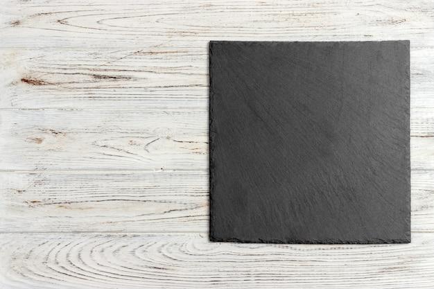 木製の黒いスレート石
