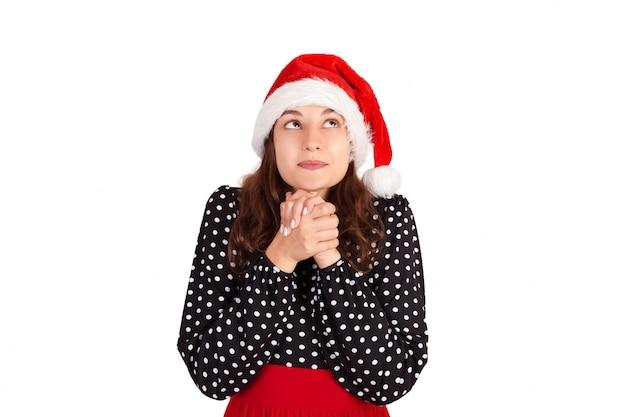 祈るジェスチャーで祈るドレスを着た女性