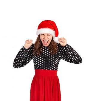 サンタクロースクリスマス帽子の感情的な少女