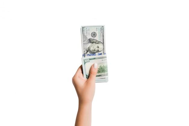 白い背景と分離お金を与える女性の手