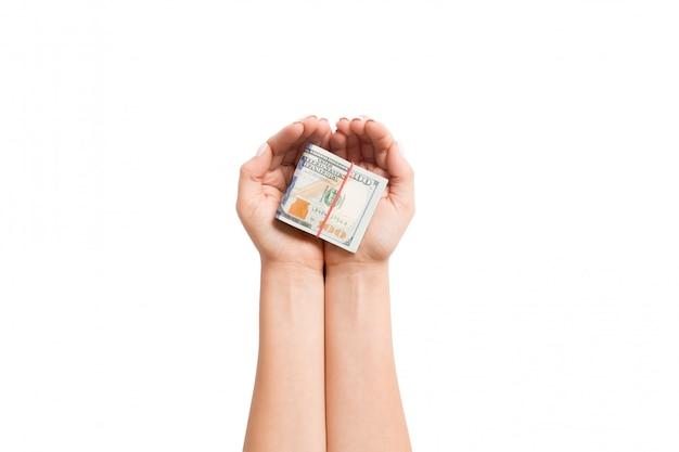 孤立した白地の女性の手でドル紙幣。退職と貧困の概念
