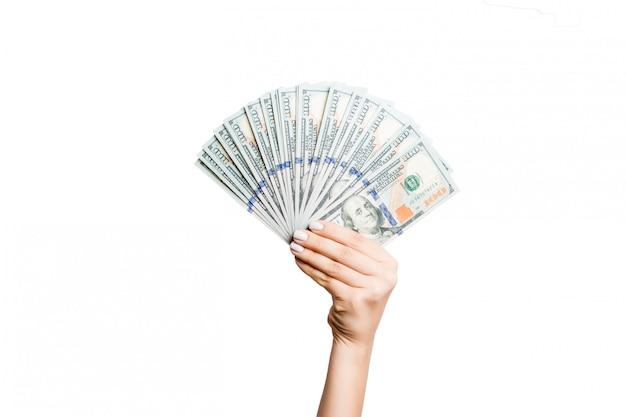 分離のドル紙幣のファンを持っている女性の手