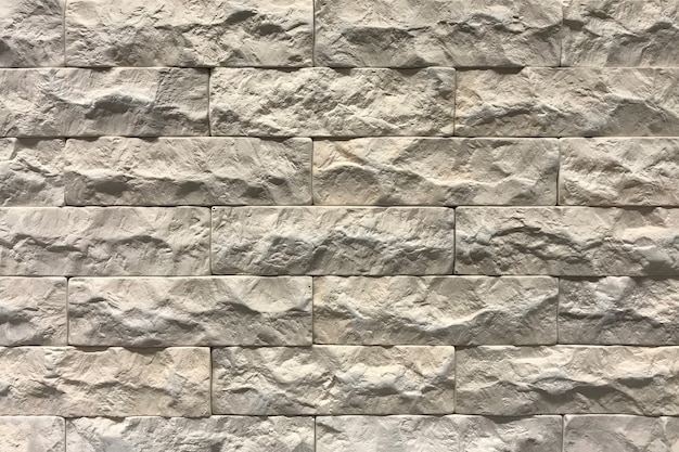Серая предпосылка текстуры кирпичной стены. плиточный с пространством справиться