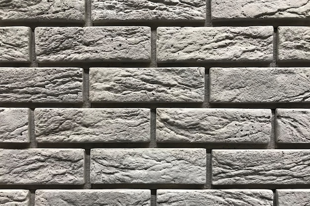 Серая предпосылка текстуры кирпичной стены. концепция дизайна интерьера с копией пространства