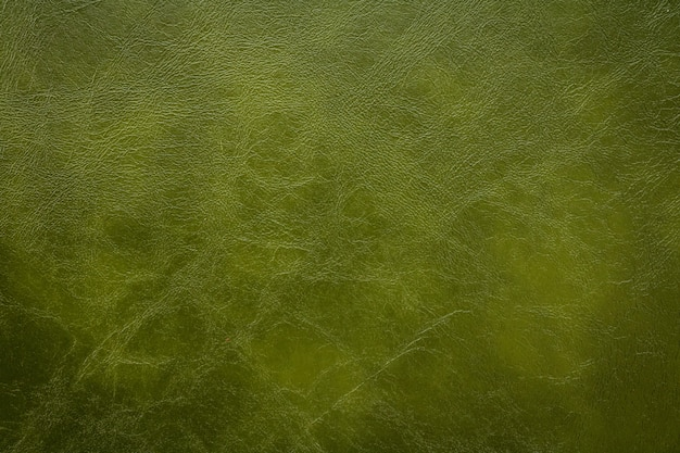 ダークグリーンレザーテクスチャ背景。人工皮革材料