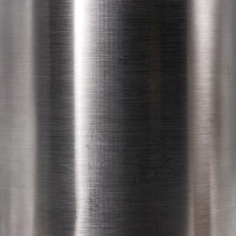 ブラッシュドスチールプレートの質感。硬質金属材料の背景。