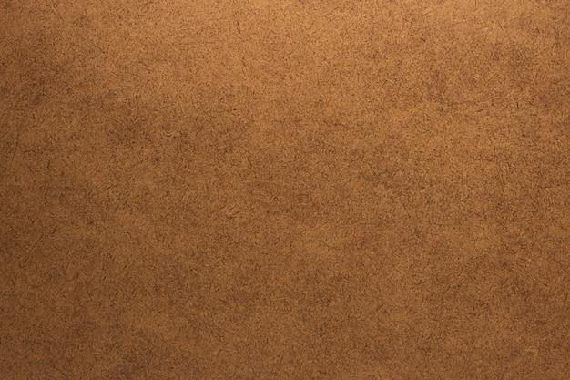 光の茶色木目テクスチャ背景。空白のアンティーク家具の素材。