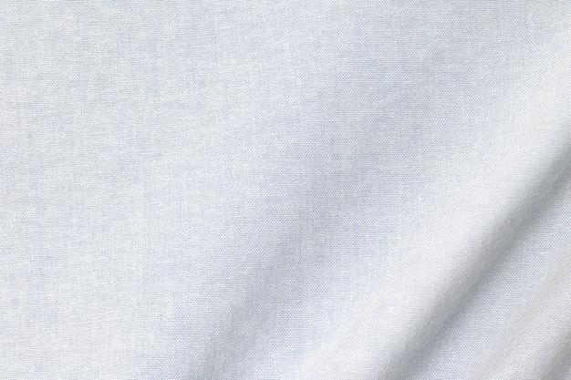 ライトコットンのテクスチャ背景。布地テキスタイル表面の詳細。