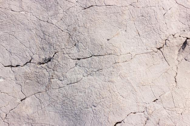 Серая горная текстура камней. природа материала фона