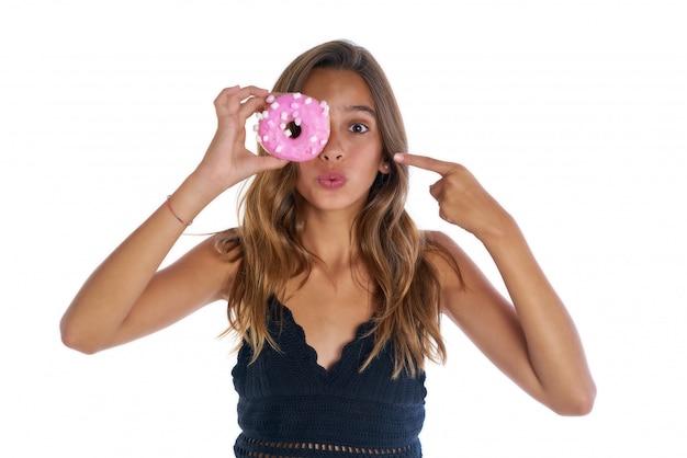 彼女の目にゴーグルを保持している十代の少女