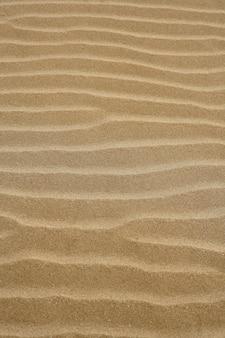 ビーチの砂の波暖かいテクスチャパターン背景