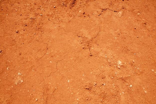 赤い土のテクスチャ背景、乾燥粘土