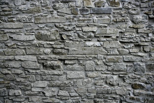 アンティークグランジ古い灰色の石造りの壁の石積み建築の質感