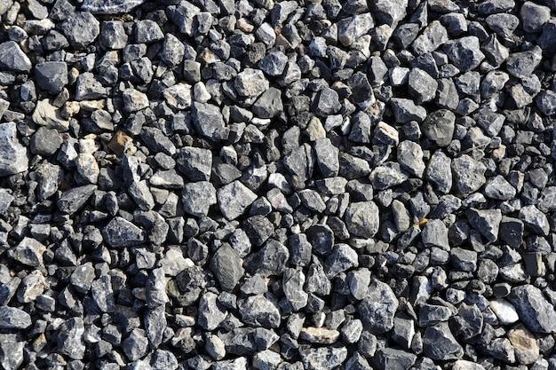 アスファルト混合コンクリートの砂利灰色の石のテクスチャ
