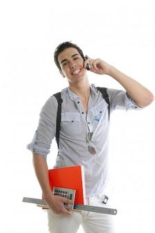 携帯電話を話しているハンサムな学生