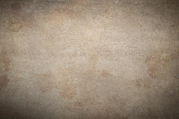 ダークブラウンの石またはスレートの壁。