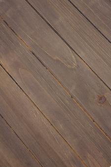 古い木製の板が斜めにテクスチャ背景を配置