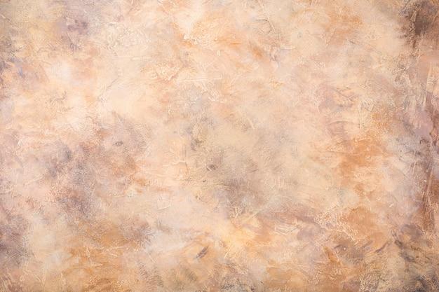 オレンジ色の砂のコンクリート石の背景テクスチャ。水平です。