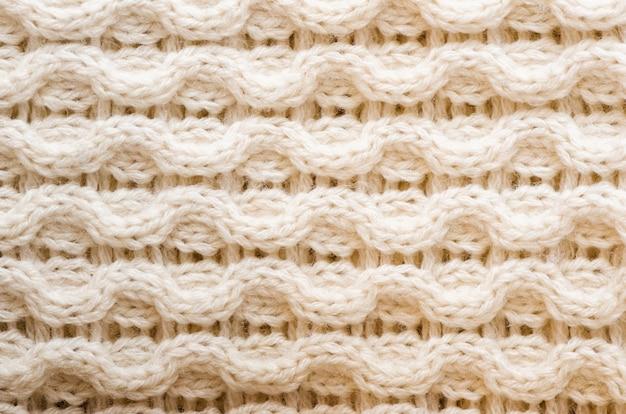 Вязаная текстура. выкройка ткани из шерсти. фон, копия пространства