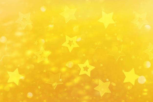 青い星とお祝いの抽象的な背景。
